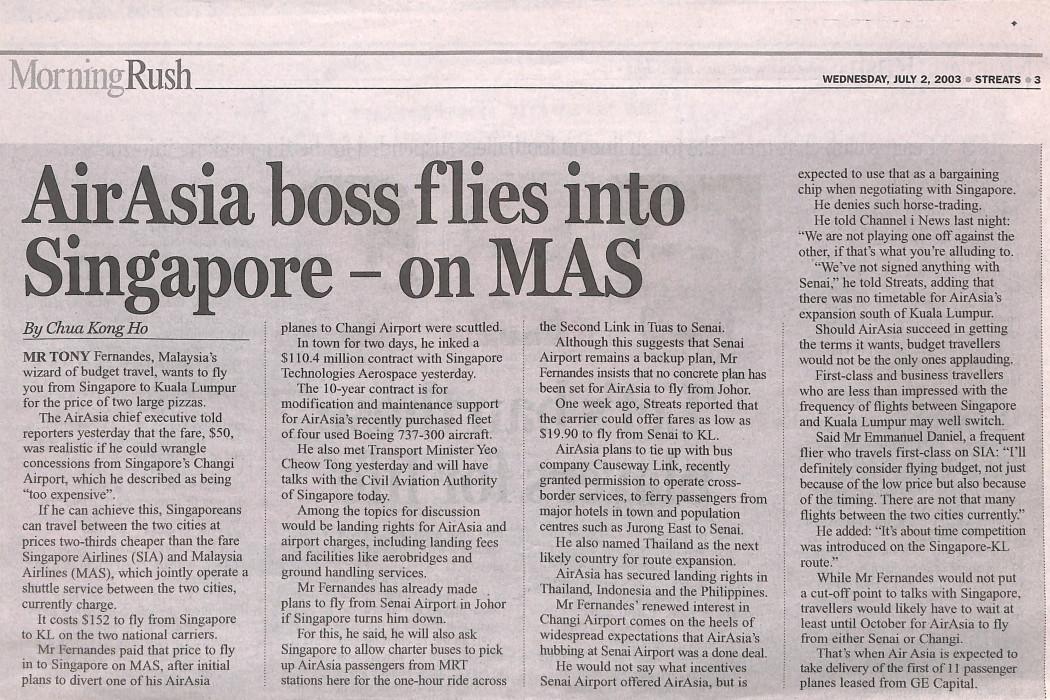 airasia boss flies into Singapore - on MAS
