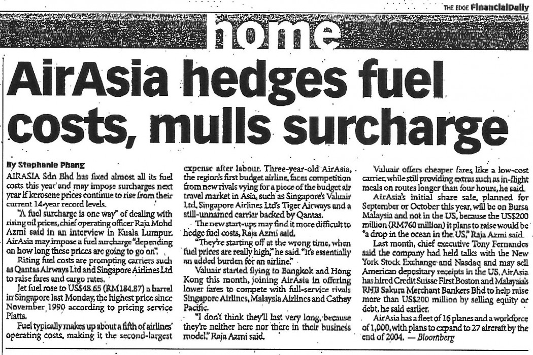 airasia hedges fuel costs, mulls surcharge