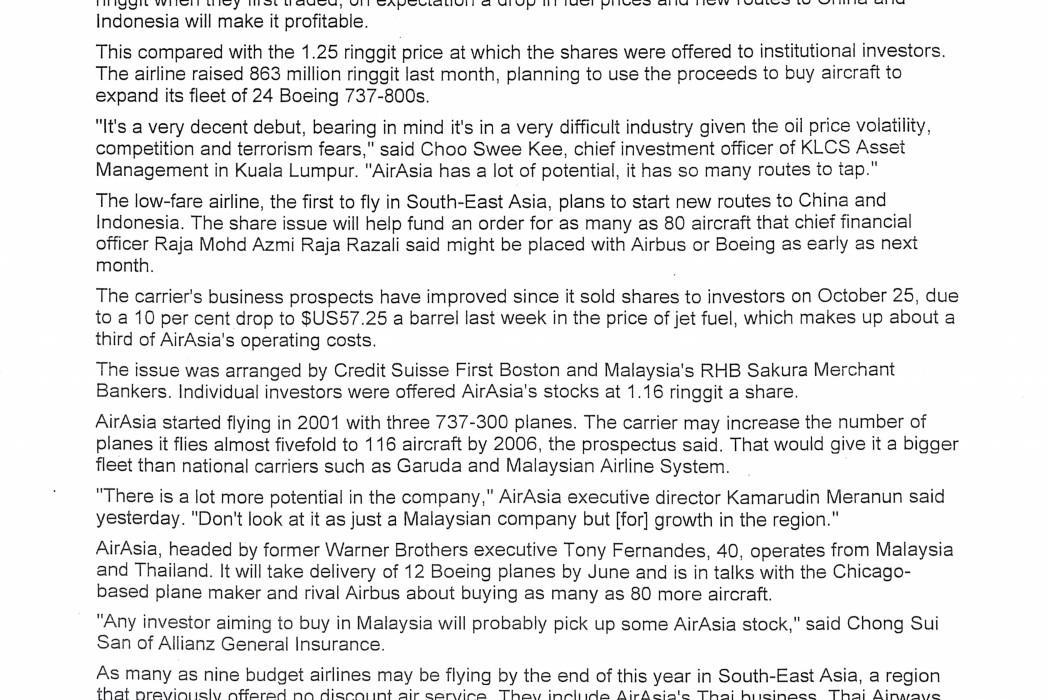 airasia lists in KL at 16% premium