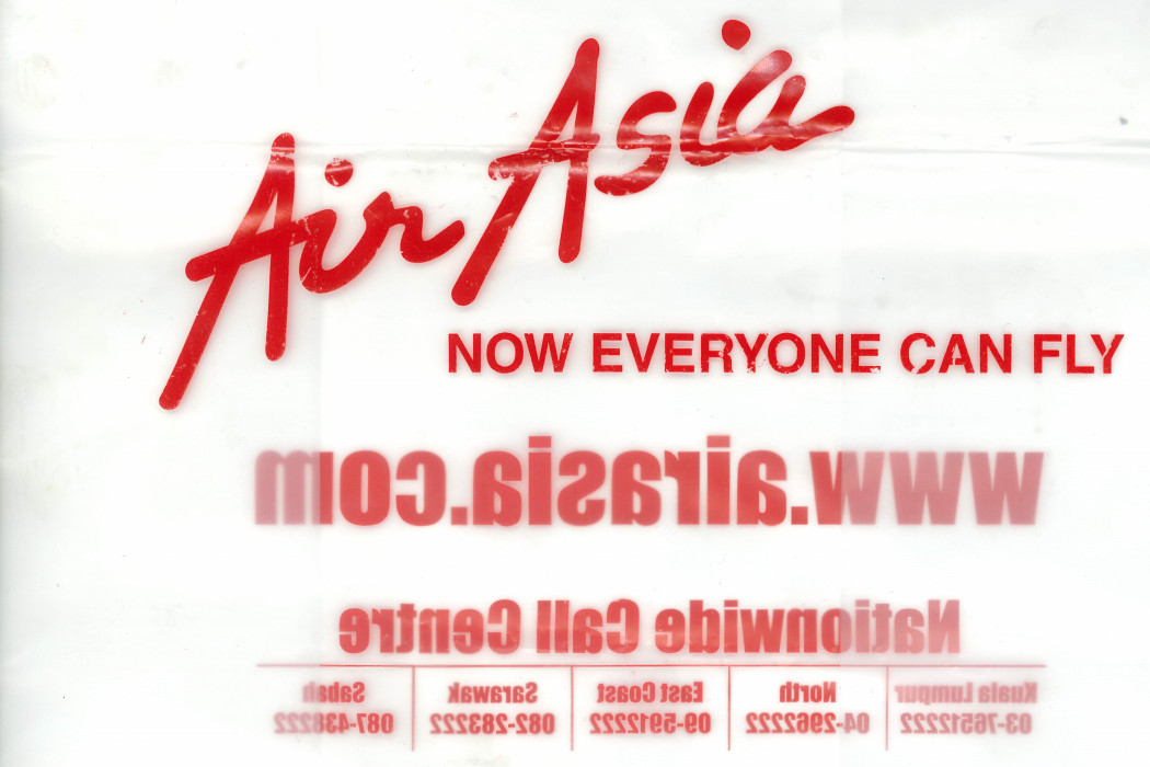 Clear Plastic Bag With airasia Logo And NOW EVERYONE CAN FLY (1)